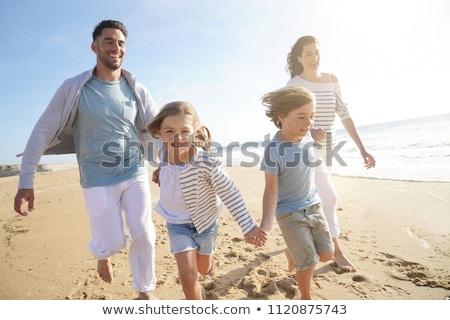 Család négy tengerpart víz lány gyerekek Stock fotó © photography33