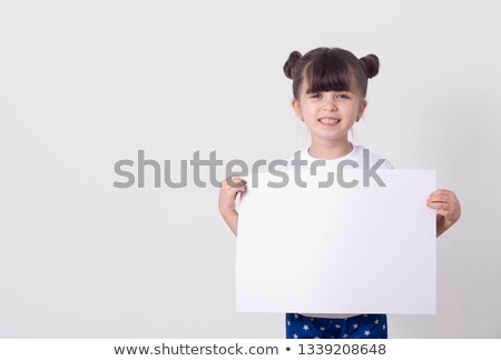 Smiling little girl holding white card for you sample text Stock photo © Len44ik