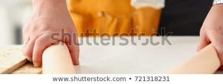 Handyman unrolling a plan Stock photo © photography33