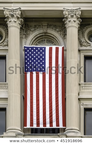 American flag hanging on the historic building. Stock photo © frank11