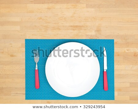 bamboo placemat with plate fork and knife isolated on white stock photo © inxti