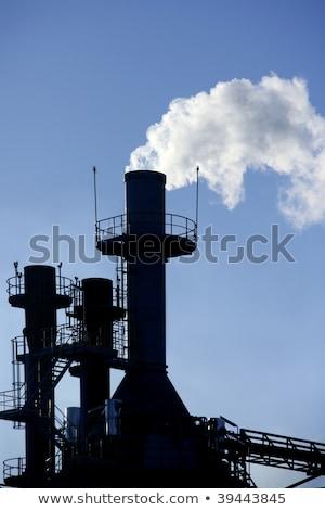 backlight petrochemical industry smoke sky stock photo © lunamarina