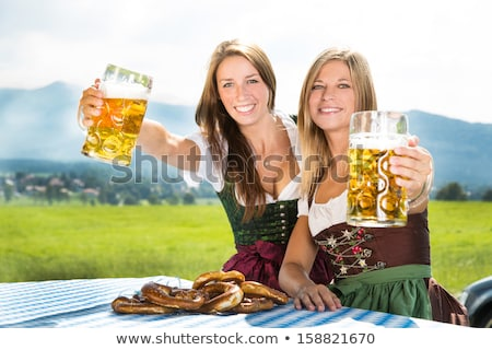 bavarian woman with beer stock photo © lordalea