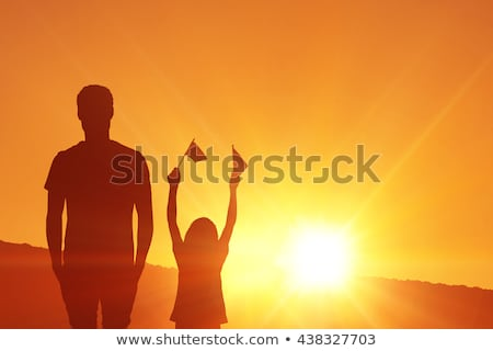 casual man looks down with hands in pockets at sunset Stock photo © feedough