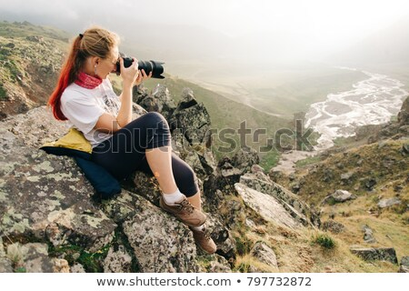 A DSLR Taking a Photo of a Wide Mountain River Stock photo © Frankljr