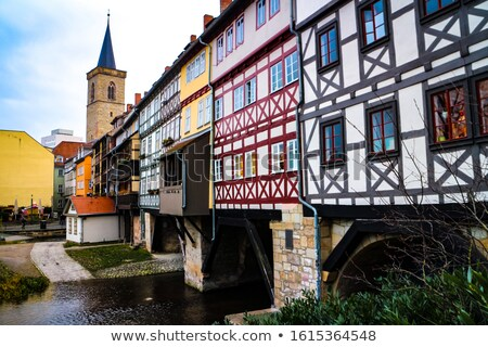 Houses on Kraemerbruecke - Merchants Bridge in Erfurt, Germany. Two narrow rows of houses are built  Stock photo © meinzahn