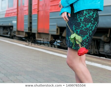 Woman waiting train with flowers at hand Stock photo © vetdoctor