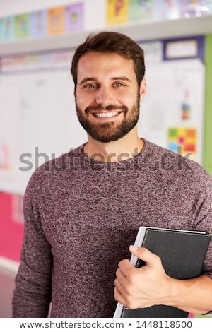 Retrato masculino escola primária professor em pé sala de aula Foto stock © monkey_business