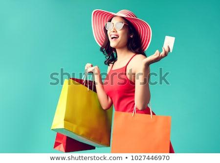 gülümseyen · kadın · kredi · kartı · alışveriş · satış · bankacılık - stok fotoğraf © dolgachov