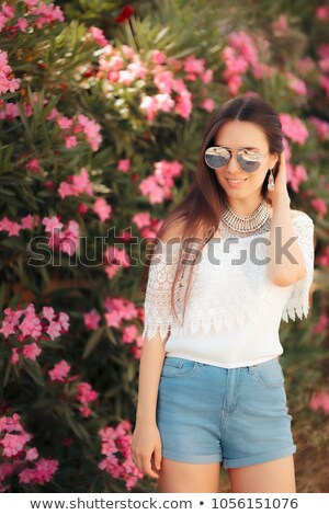 portrait of woman wearing white lace top stock photo © dash