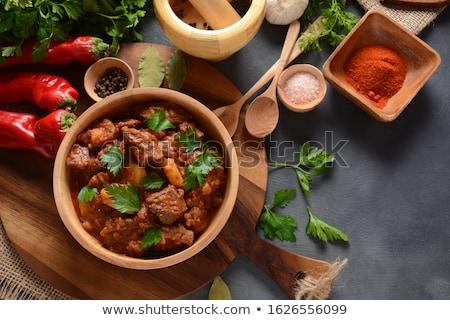 estofado · perejil · servido · blanco · tazón · alimentos - foto stock © yelenayemchuk