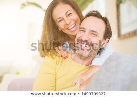 Retrato feliz mulher sofá Foto stock © deandrobot