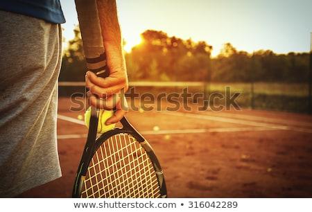 Sports man holding tennis ball and racket Stock photo © deandrobot