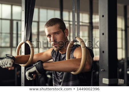 Fitness dip ring man relaxed after workout Stock photo © stryjek