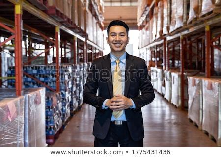 Confident Supervisor Standing At Warehouse Stok fotoğraf © vichie81