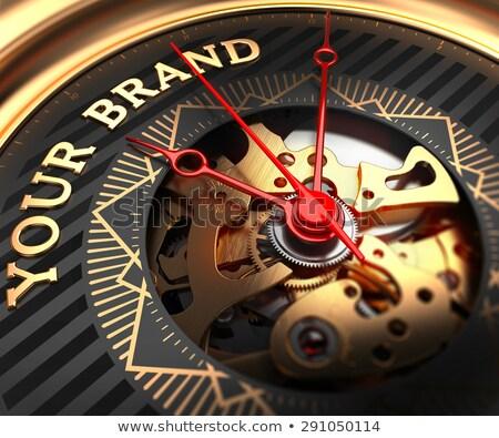 Your Brand on Black-Golden Watch Face. Stock photo © tashatuvango