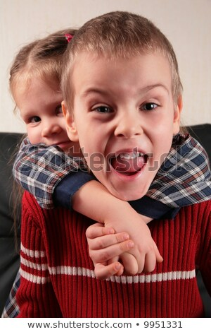 girl embraces boy for the neck, aggressive defence boy Stock photo © Paha_L