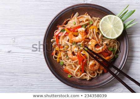 Delicious rice noodles with shrimp close-up on a plate. Thai Dis Stock photo © art9858