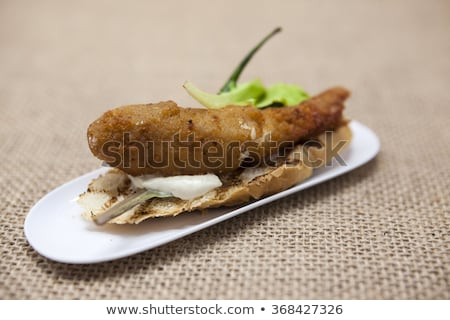 thai grilled tiger shrimp on a slice of baguette white with red chili peppers and lettuce spanish stock photo © mcherevan