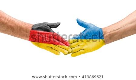 Futball csapatok kézfogás Németország Ukrajna kéz Stock fotó © Zerbor