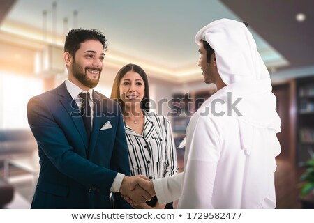 arabic business man offering handshake stock photo © zurijeta