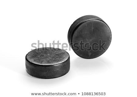 Two ice hockey pucks Stock photo © magraphics