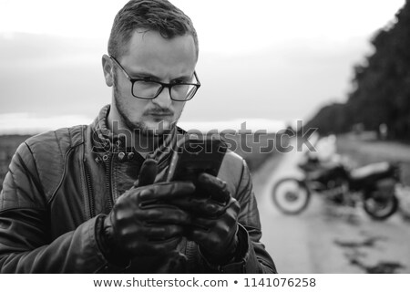 Close up of motorcycle with a man on the backgroud Stock photo © deandrobot