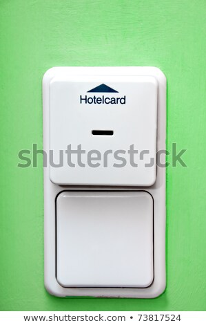 hotel card holder on green wall and light switch Stock photo © tarczas