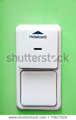 Hôtel carte vert mur interrupteur de lumière technologie Photo stock © tarczas