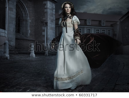 Dynamic photo of a young lady Stock photo © konradbak
