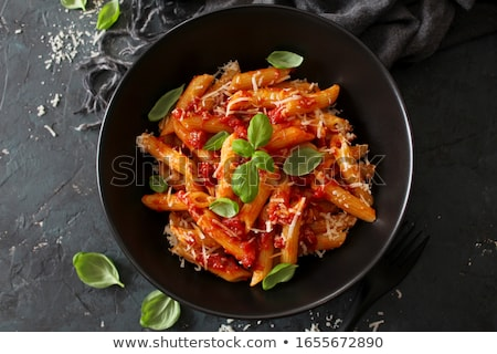 Penne pasta with tomato sauce Stock photo © bluering