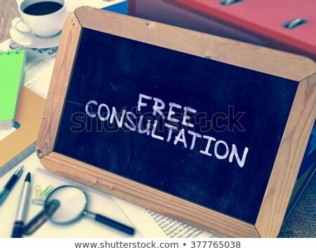 Libero consultazione lavagna lavoro tavola Foto d'archivio © tashatuvango