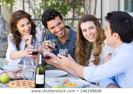 Fericit prietenii vin rosu mese restaurant afaceri Imagine de stoc © wavebreak_media