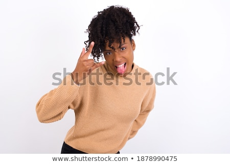Portret mooie afrikaanse vrouw tonen tong Stockfoto © deandrobot