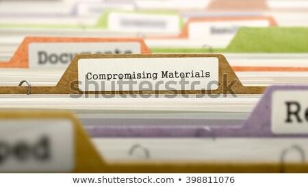 compromising materials concept on file label stock photo © tashatuvango