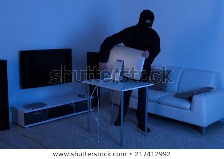 Rubare televisione soggiorno maschio casa tavola Foto d'archivio © AndreyPopov
