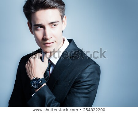 happy man touching chin is thinking and smiling  Stock photo © feedough