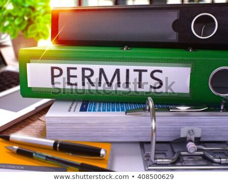 Permits on Green Office Folder. Toned Image. Stock photo © tashatuvango