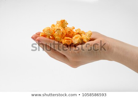 female hand holds sweet and salty popcorn on white stock photo © denismart