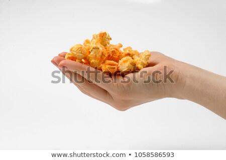 Női kéz édes sós pattogatott kukorica fehér Stock fotó © DenisMArt