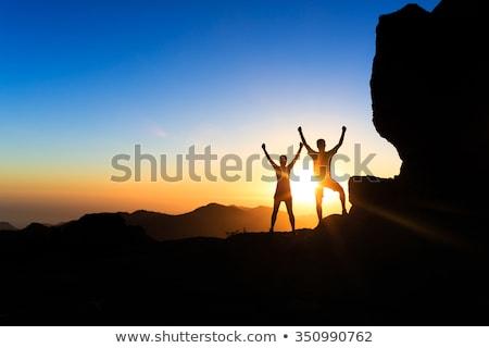 Woman hiking and camping in inspiring mountain landscape Stock photo © blasbike