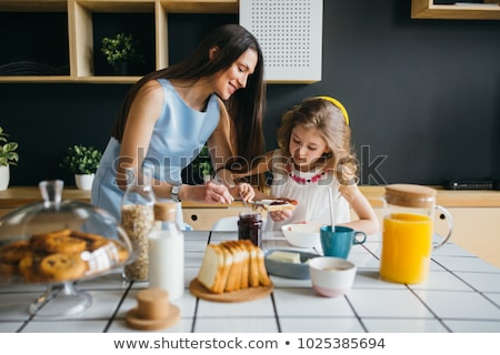 mother and daughter making jam stock photo © is2