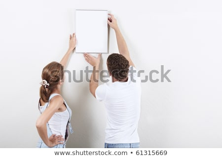 couple hanging up a picture Stock photo © IS2
