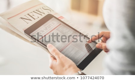 woman reading online news on digital tablet stock photo © stevanovicigor