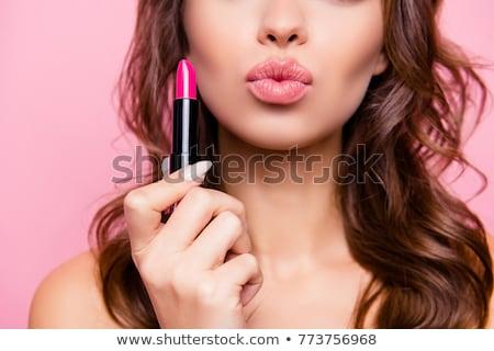 beautiful model girl holding lipstick tube makeup stock photo © denismart