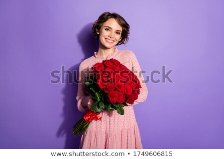 Woman holding flowers in her hands Stock photo © IS2