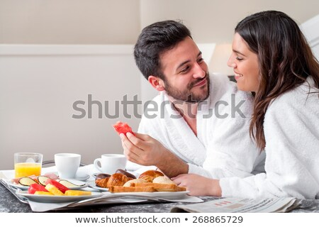 Romantic couple cuddling with breakfast tray on bed Stock photo © wavebreak_media