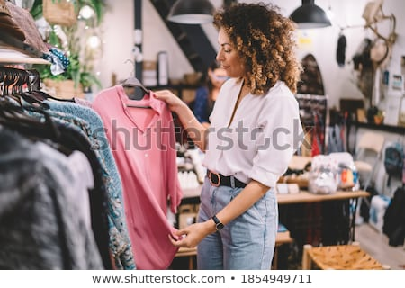 Woman selecting an apparel while shopping for clothes Stock photo © wavebreak_media