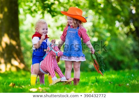 Girls dressed up as cowgirl Stock photo © IS2