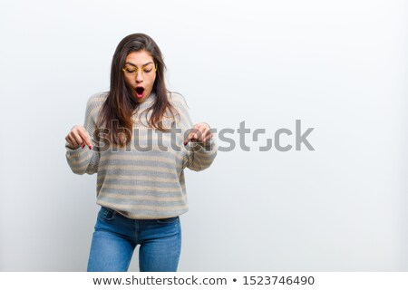 Young female looking downwards Stock photo © IS2